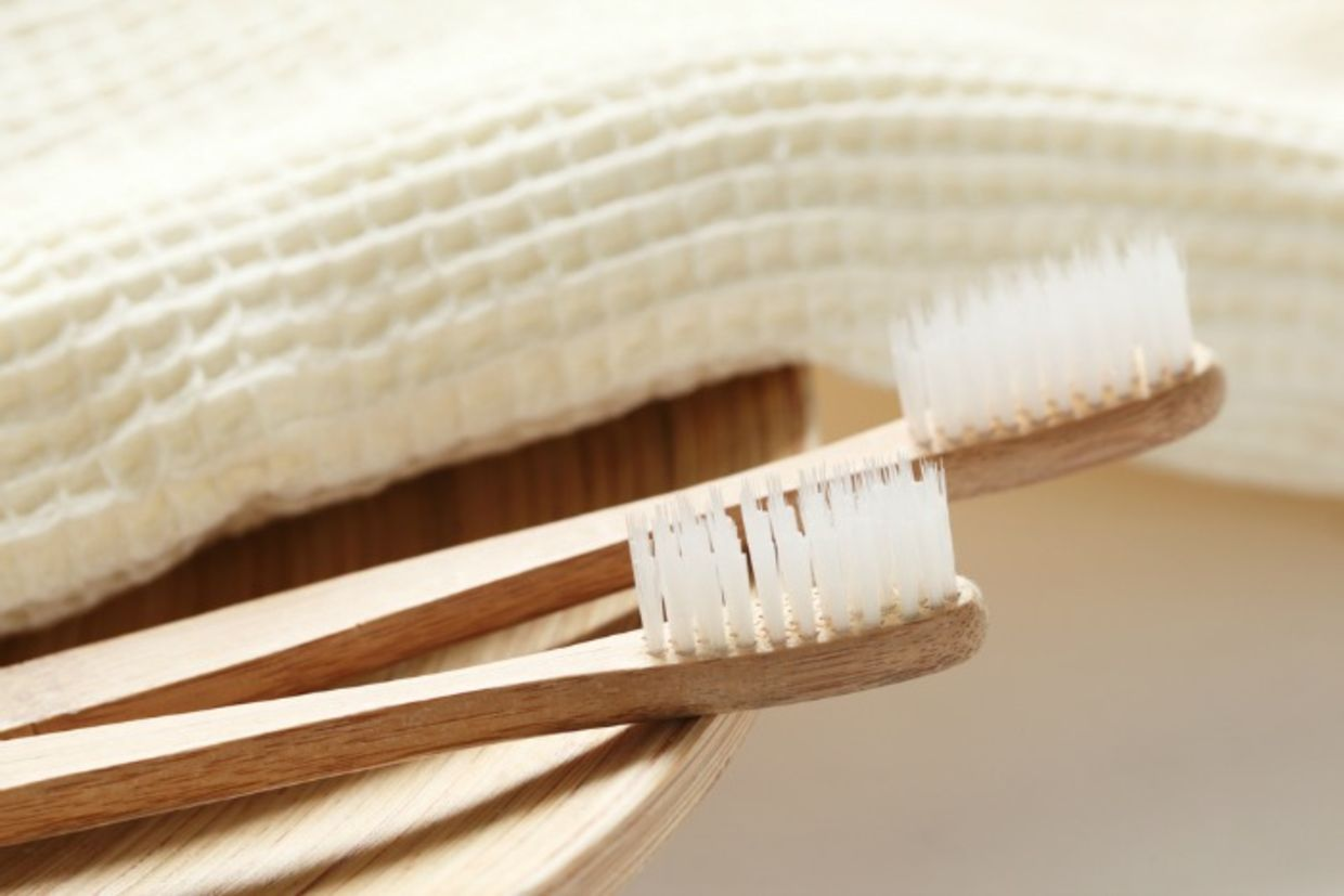 Bamboo toothbrushes provide a eco-friendly alternative to the plastic variety (Shutterstock)